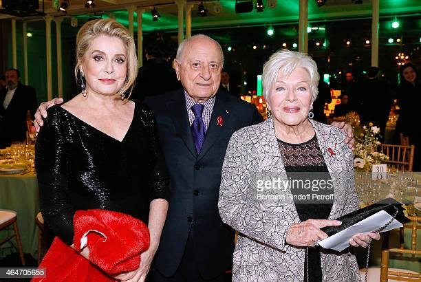 Actress Catherine Deneuve Pierre berge and Line Renaud attend the Sidaction Gala Dinner 2014 at Pavillon d'Armenonville on January 23 2014 in Paris...