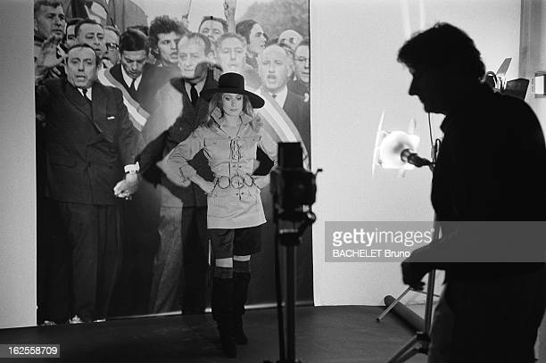 Actress Catherine Deneuve poses in YSL fashions in a photoshoot by German photographer Helmut Newton 16th November 1981 Deneuve is posing in front of...