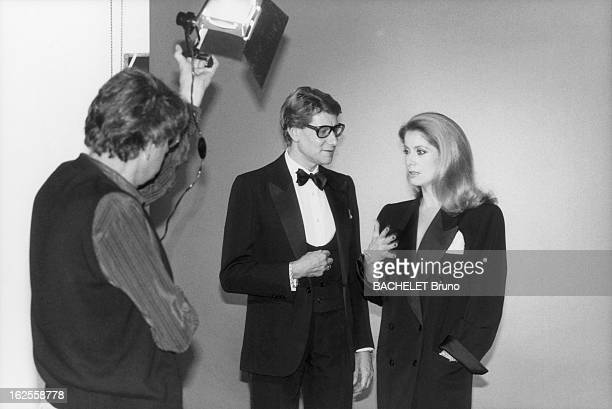 Actress Catherine Deneuve poses in YSL fashions with designer Yves Saint Laurent in a photoshoot by German photographer Helmut Newton 16th November...