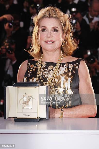 Actress Catherine Deneuve with the Special Award of the 61st Festival de Cannes during the Palme d'Or Closing Ceremony Photocall at the Palais des...