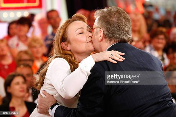 Actress Catherine Frot and main guest of the show Dominique Besnehard attend the 'Vivement Dimanche' French TV show Held at Pavillon Gabriel on April...