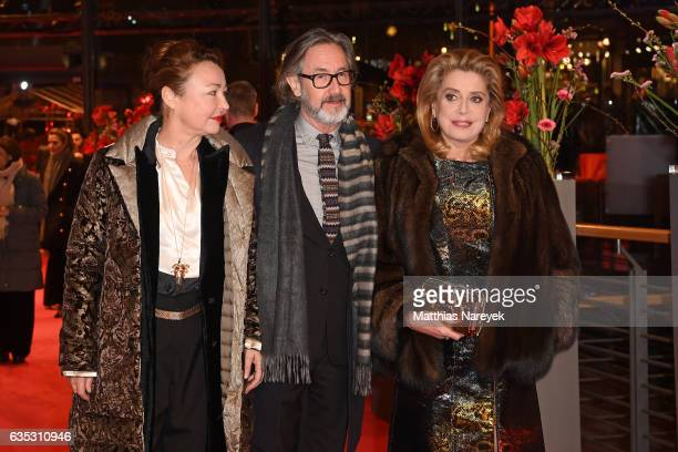 Actress Catherine FrotDirector Martin Provost And Actress Catherine Deneuve attend the 'The Midwife' premiere during the 67th Berlinale International...