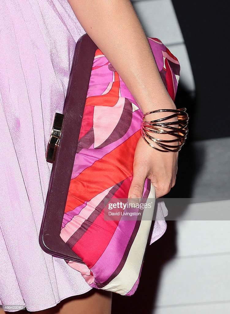 Actress Catherine Haena Kim (purse & bracelet detail) attends the Maxim Hot 100 event at the Pacific Design Center on June 10, 2014 in West Hollywood, California.