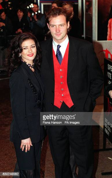 Actress Catherine Zeta Jone arrives with BBC's Blue Peter presenter John Leslie for the celebrity premiere of Bram Stoker's Dracula directed by...