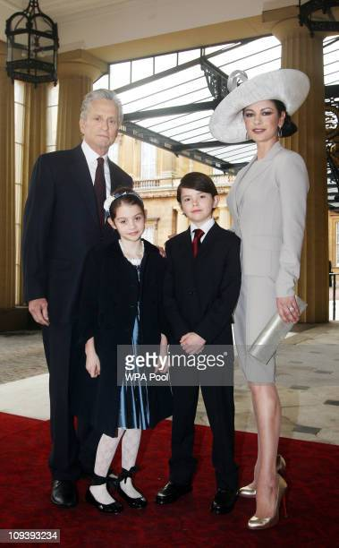 Actress Catherine Zeta Jones arrives with her husband actor Michael Douglas and their children Dylan and Carys Douglas to attend a Royal Investiture...