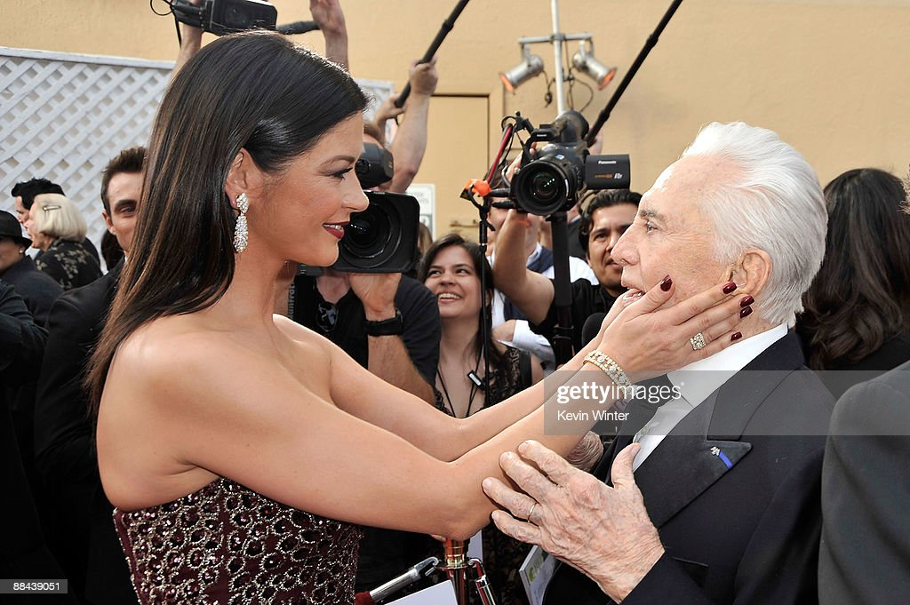 Actress Catherine Zeta-Jones and actor Kirk Douglas arrive at the AFI Life Achievement Awards: A Tribute to Michael Douglas at Sony Pictures Studios on June 11, 2009 in Culver City, California.