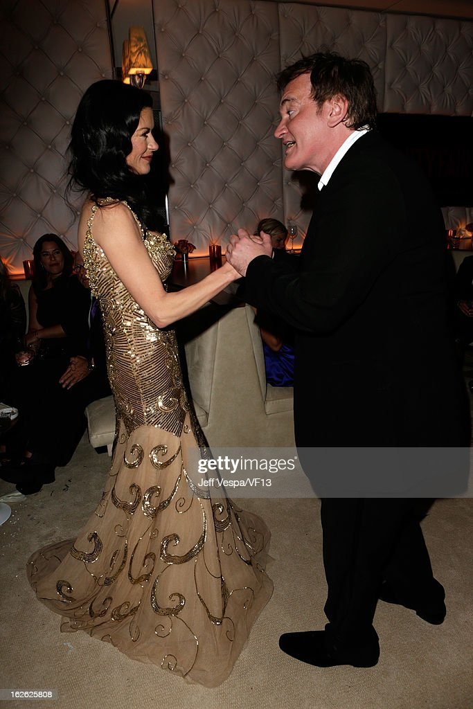 Actress Catherine Zeta-Jones (L) and director Quentin Tarantino attend the 2013 Vanity Fair Oscar Party hosted by Graydon Carter at Sunset Tower on February 24, 2013 in West Hollywood, California.