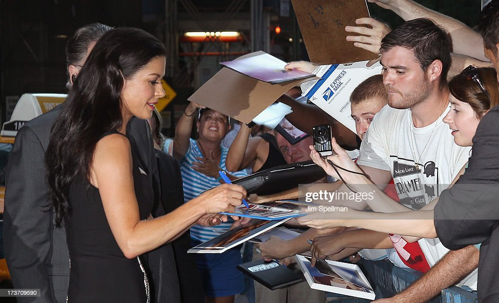 Actress Catherine Zeta-Jones and fans attend The Cinema Society & Bally screening of Summit Entertainment's 'Red 2' at the Museum of Modern Art on July 16, 2013 in New York City.