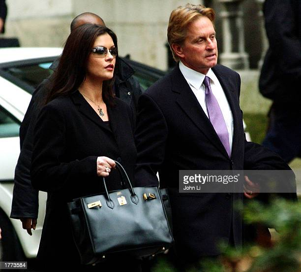 Actress Catherine ZetaJones and her husband actor Michael Douglas leave the Royal Courts of Justice after testifying February 10 2003 in London The...
