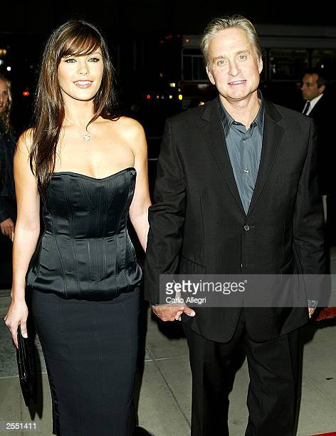 Actress Catherine ZetaJones and husband Michael Douglas arrive for the world premiere of the film 'Intolerable Cruelty' September 30 2003 in Beverly...