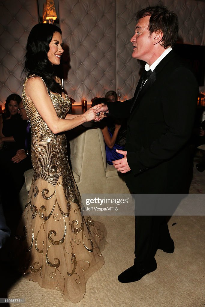 Actress Catherine Zeta-Jones and Writer/director Quentin Tarantino attend the 2013 Vanity Fair Oscar Party hosted by Graydon Carter at Sunset Tower on February 24, 2013 in West Hollywood, California.