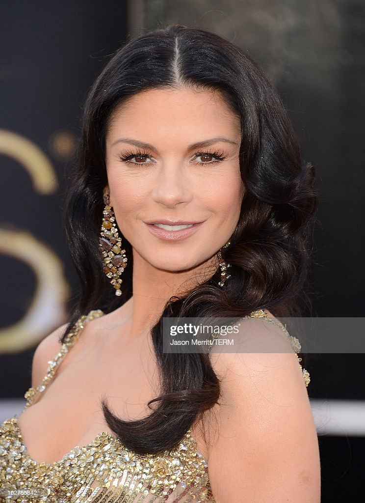 Actress <a gi-track='captionPersonalityLinkClicked' href=/galleries/search?phrase=Catherine+Zeta-Jones&family=editorial&specificpeople=167111 ng-click='$event.stopPropagation()'>Catherine Zeta-Jones</a> arrives at the Oscars at Hollywood & Highland Center on February 24, 2013 in Hollywood, California.