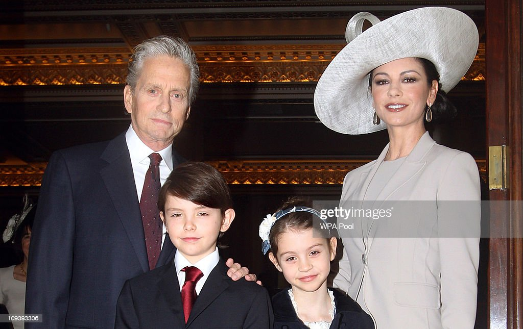 Actress Catherine Zeta-Jones (R) arrives with her husband, actor <a gi-track='captionPersonalityLinkClicked' href=/galleries/search?phrase=Michael+Douglas&family=editorial&specificpeople=171111 ng-click='$event.stopPropagation()'>Michael Douglas</a> and their children Dylan and Carys Douglas, to attend a Royal Investiture at Buckingham Palace on February 24, 2011 in London, England. The 41-year-old Swansea-born actress Catherine Zeta-Jones, who became an Oscar-winning Hollywood star was presented with a CBE by Prince Charles, Prince of Wale in honour of services to the film industry and to charity.