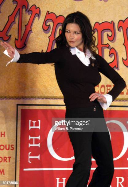 Actress Catherine ZetaJones gestures as she performs during the Hasty Pudding Theatrical's Woman of the Year ceremonies at Harvard University...