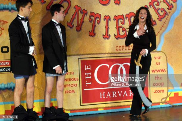 Actress Catherine ZetaJones reacts to Hasty Pudding Theatricals President Mathew Ferrante and Vice President of the Cast Sam Gale Rosen during a...