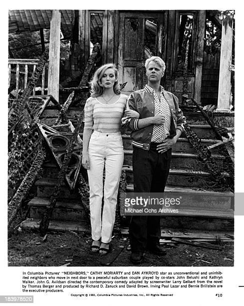Actress Cathy Moriarty and actor Dan Aykroyd on set of the Columbia Pictures movie 'Neighbors' in 1981