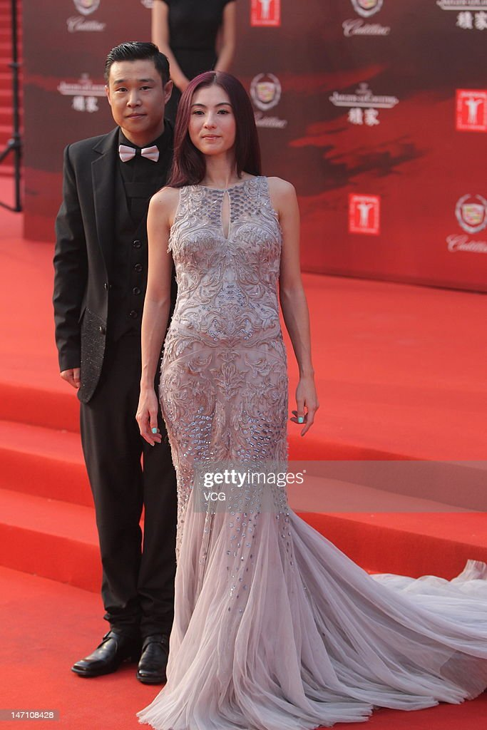 Actress Cecilia Cheung and actor Xiao Shenyang arrive at the red carpet during the closing ceremony for the 15th Shanghai International Film Festival...