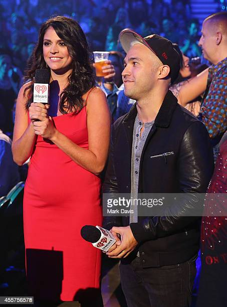 Actress Cecily Strong and musician Pete Wentz speak onstage during the 2014 iHeartRadio Music Festival at the MGM Grand Garden Arena on September 19...