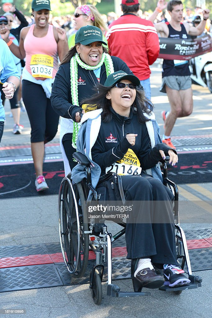Actress <a gi-track='captionPersonalityLinkClicked' href=/galleries/search?phrase=Chandra+Wilson&family=editorial&specificpeople=457286 ng-click='$event.stopPropagation()'>Chandra Wilson</a> and her daughter Joy cross the finish line at the Kaiser Permanente Rock 'n' Roll Half Marathon and Mini Marathon to benefit CureMito!at the Rose Bowl on February 17, 2013 in Pasadena, California.