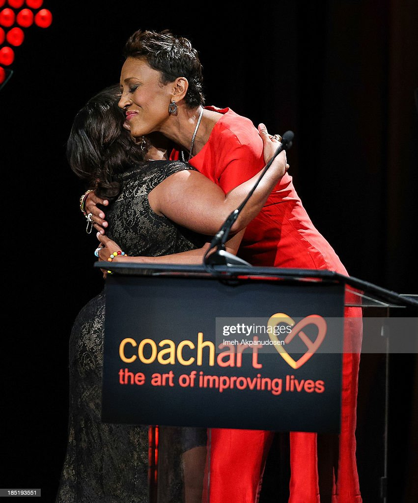 Actress Chandra Wilson (L) and telelvision personality Robin Roberts onstage during CoachArt's 9th Annual 'Gala Of Champions' at The Beverly Hilton Hotel on October 17, 2013 in Beverly Hills, California.