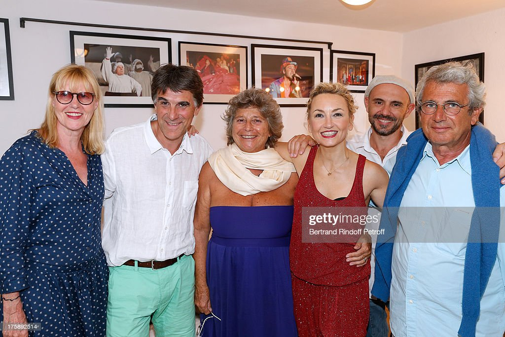 Actress Chantal Ladesou, humorist Tex, President of Ramatuelle Festival Jacqueline Franjou, humorist Christelle Chollet, her husband Remy Caccia and Artistic Director of the Festival <a gi-track='captionPersonalityLinkClicked' href=/galleries/search?phrase=Michel+Boujenah&family=editorial&specificpeople=1027167 ng-click='$event.stopPropagation()'>Michel Boujenah</a> after Christelle Chollet one woman show 'The New Show', written and set stage by Remy Caccia at 29th Ramatuelle Festival day 10 on August 9, 2013 in Ramatuelle, France.