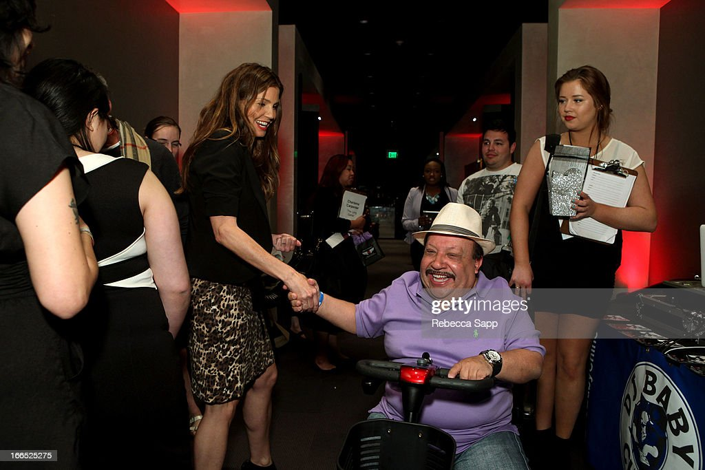 Actress <a gi-track='captionPersonalityLinkClicked' href=/galleries/search?phrase=Charisma+Carpenter&family=editorial&specificpeople=227217 ng-click='$event.stopPropagation()'>Charisma Carpenter</a> and actor Chuy Bravo at GBK Gift Lounge In Honor Of The MTV Movie Award Nominees And Presenters - Day 2 at W Hollywood on April 13, 2013 in Hollywood, California.