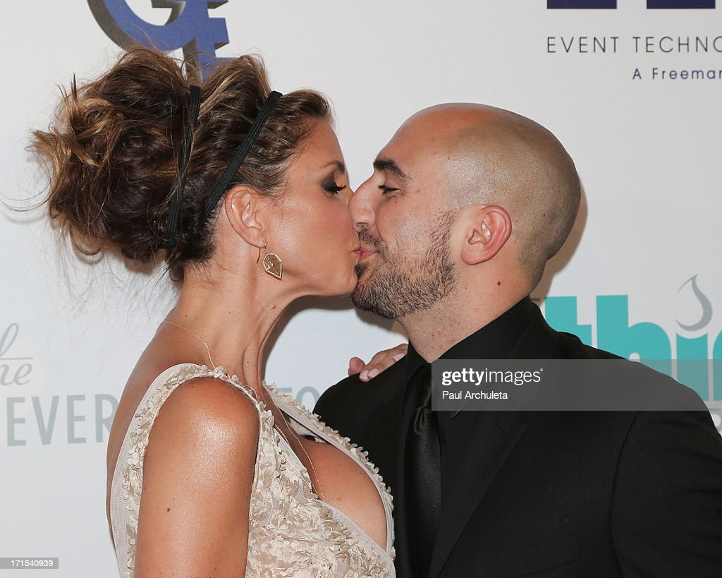 Actress Charisma Carpenter (L) and her Boyfriend Michael T. Rossi (R) attend the 4th annual Thirst Gala at The Beverly Hilton Hotel on June 25, 2013 in Beverly Hills, California.