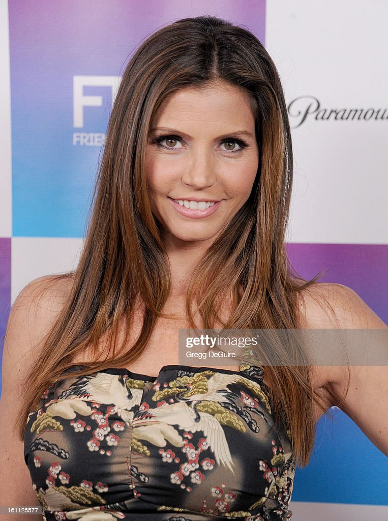 Actress Charisma Carpenter arrives at The Grammy Awards: Friends 'N' Family party at Paramount Studios on February 8, 2013 in Hollywood, California.