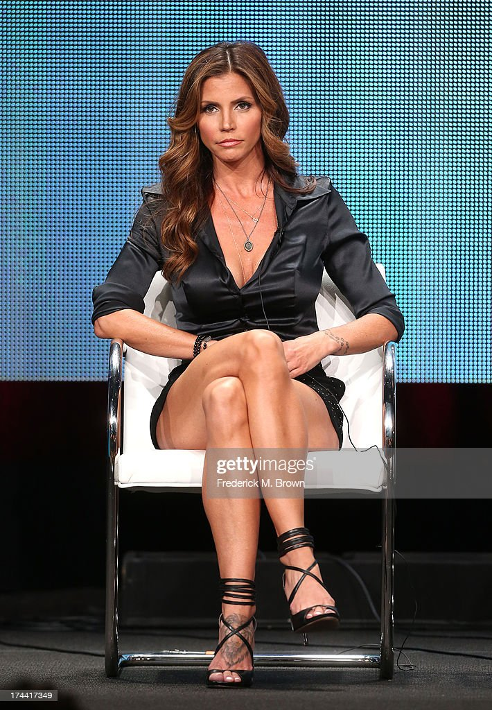 Actress <a gi-track='captionPersonalityLinkClicked' href=/galleries/search?phrase=Charisma+Carpenter&family=editorial&specificpeople=227217 ng-click='$event.stopPropagation()'>Charisma Carpenter</a> speaks onstage at the ' Surviving Evil With <a gi-track='captionPersonalityLinkClicked' href=/galleries/search?phrase=Charisma+Carpenter&family=editorial&specificpeople=227217 ng-click='$event.stopPropagation()'>Charisma Carpenter</a>' panel discussion during the Investigation Discovery portion of the 2013 Summer Television Critics Association tour - Day 2 at the Beverly Hilton Hotel on July 25, 2013 in Beverly Hills, California.