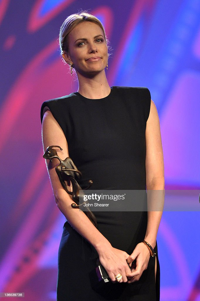 Actress Charlize Theron accepts the Vanguard Award for Creative Ensemble onstage during The 23rd Annual Palm Springs International Film Festival Awards Gala at the Palm Springs Convention Center on January 7, 2012 in Palm Springs, California.
