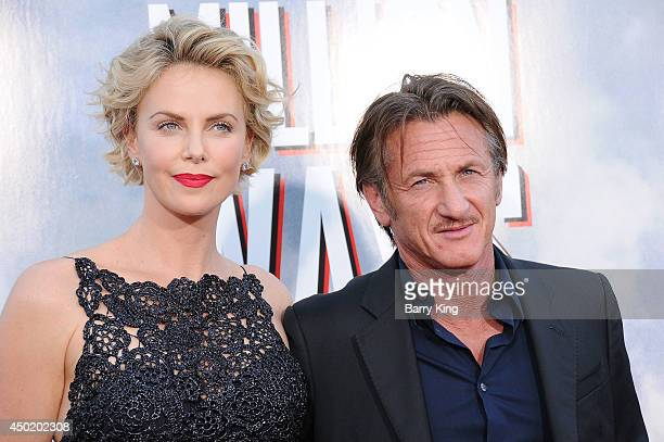 Actress Charlize Theron and actor Sean Penn arrive at the Los Angeles Premiere 'A Million Ways To Die In The West' on May 15 2014 at Regency Village...