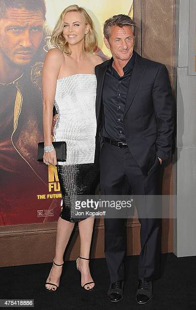 Actress Charlize Theron and actor Sean Penn arrive at the Los Angeles Premiere 'Mad Max Fury Road' at TCL Chinese Theatre IMAX on May 7 2015 in...