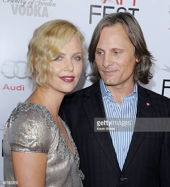 Actress Charlize Theron and actor Viggo Mortensen arrive at the AFI FEST 2009 screening of 'The Road' at the Chinese Theater on November 4 2009 in...