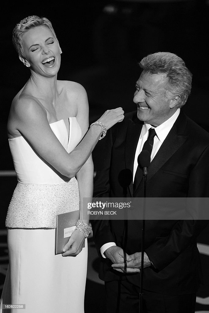 Actress Charlize Theron and Dustin Hoffman present an award onstage at the 85th Annual Academy Awards on February 24, 2013 in Hollywood, California. AFP PHOTO/Robyn BECK