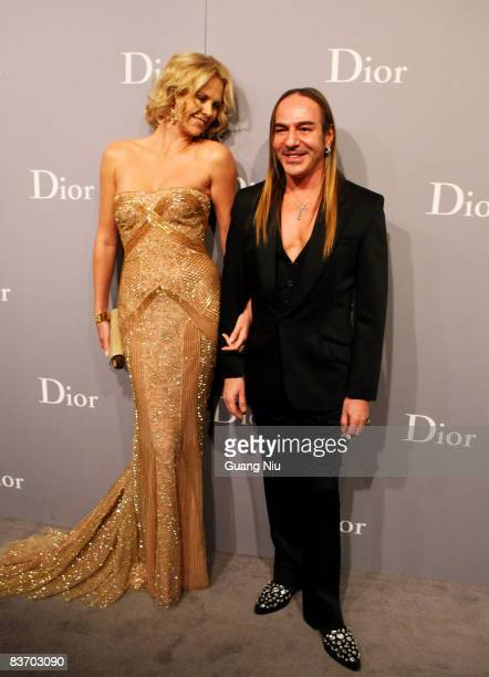 Actress Charlize Theron and John Galliano arrive at Christian Dior Chinese Artists on Novermber 15 2008 in Beijing China