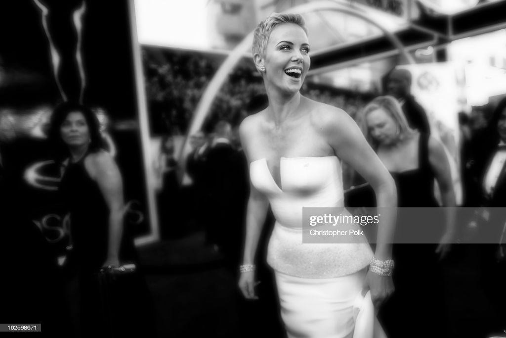 Actress <a gi-track='captionPersonalityLinkClicked' href=/galleries/search?phrase=Charlize+Theron&family=editorial&specificpeople=171250 ng-click='$event.stopPropagation()'>Charlize Theron</a> arrives at Hollywood & Highland Center on February 24, 2013 in Hollywood, California.