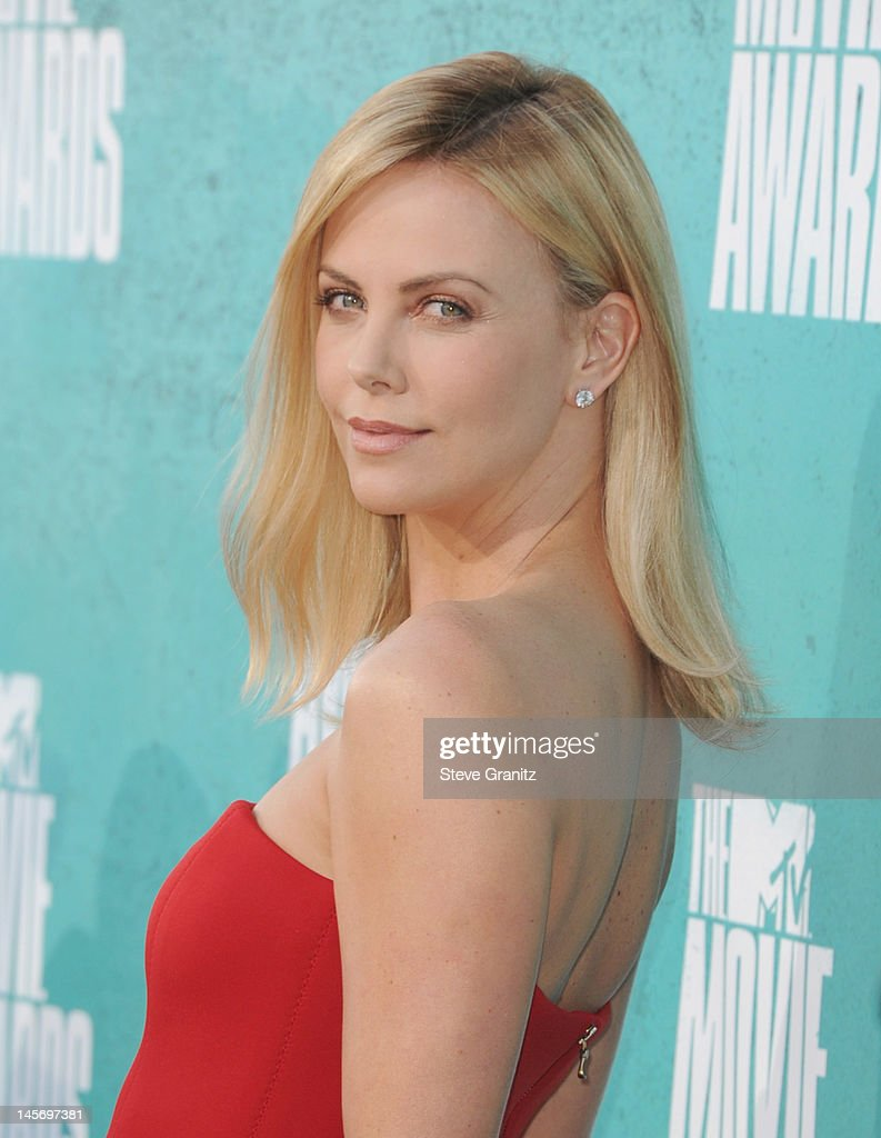 Actress Charlize Theron arrives at the 2012 MTV Movie Awards at Gibson Amphitheatre on June 3, 2012 in Universal City, California.