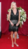 Actress Charlize Theron arrives at the 57th Annual Emmy Awards held at the Shrine Auditorium on September 18 2005 in Los Angeles California