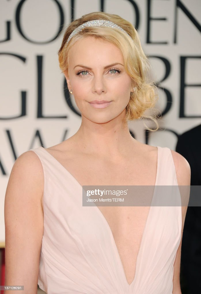 Actress <a gi-track='captionPersonalityLinkClicked' href=/galleries/search?phrase=Charlize+Theron&family=editorial&specificpeople=171250 ng-click='$event.stopPropagation()'>Charlize Theron</a> arrives at the 69th Annual Golden Globe Awards held at the Beverly Hilton Hotel on January 15, 2012 in Beverly Hills, California.