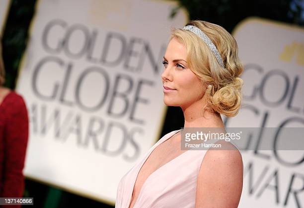 Actress Charlize Theron arrives at the 69th Annual Golden Globe Awards held at the Beverly Hilton Hotel on January 15 2012 in Beverly Hills California