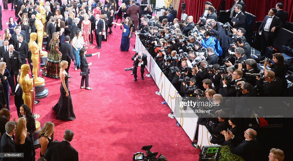 Actress <a gi-track='captionPersonalityLinkClicked' href=/galleries/search?phrase=Charlize+Theron&family=editorial&specificpeople=171250 ng-click='$event.stopPropagation()'>Charlize Theron</a> arrives at the 86th Annual Academy Awards at Hollywood & Highland Center on March 2, 2014 in Hollywood, California.