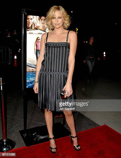 Actress Charlize Theron arrives at the Los Angeles Premiere 'Sleepwalking' at the Directors Guild of America on March 6 2007 in Los Angeles California