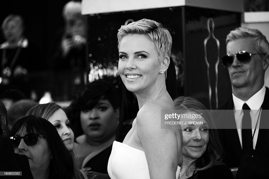 Actress Charlize Theron arrives on the red carpet for the 85th Annual Academy Awards on February 24, 2013 in Hollywood, California.