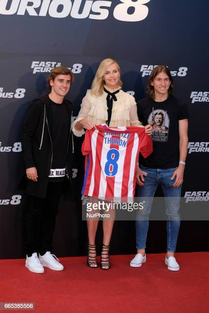 Actress Charlize Theron Atleico de Madrid players Antoine Griezmann and Filipe Luis attend the photocall of FAST amp FURIOUS 8 in Madrid Spain April...