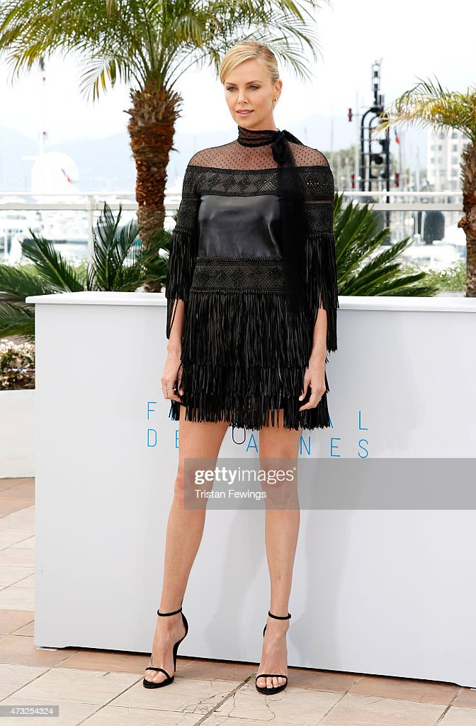Actress <a gi-track='captionPersonalityLinkClicked' href=/galleries/search?phrase=Charlize+Theron&family=editorial&specificpeople=171250 ng-click='$event.stopPropagation()'>Charlize Theron</a> attends a photocall for 'Mad Max: Fury Road' during the 68th annual Cannes Film Festival on May 14, 2015 in Cannes, France.