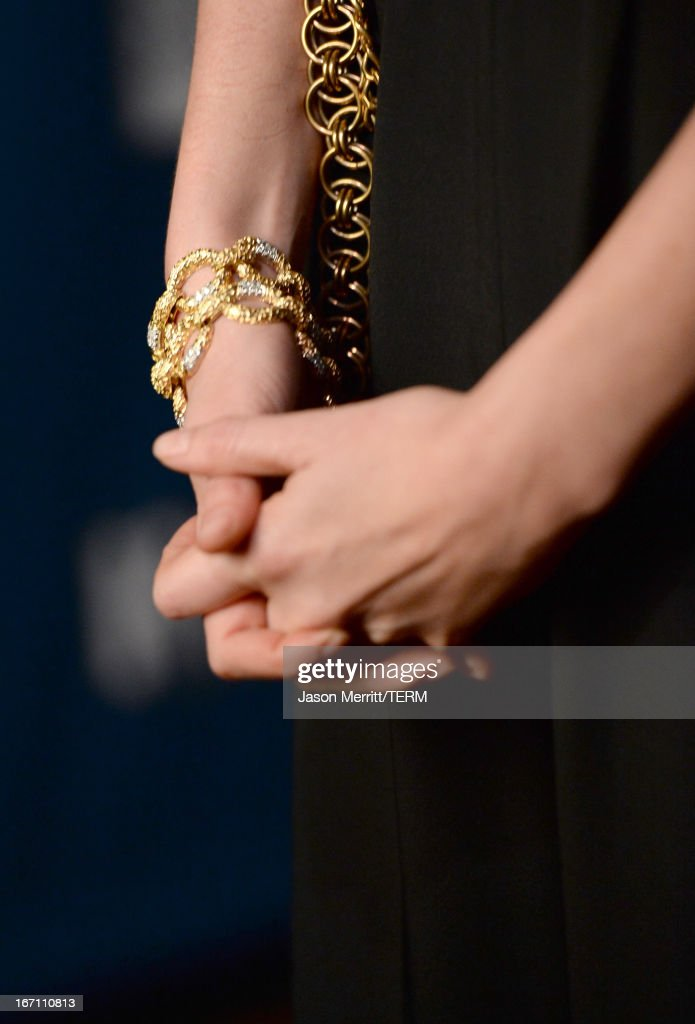 Actress Charlize Theron (jewelry detail) attends the 24th Annual GLAAD Media Awards at JW Marriott Los Angeles at L.A. LIVE on April 20, 2013 in Los Angeles, California.
