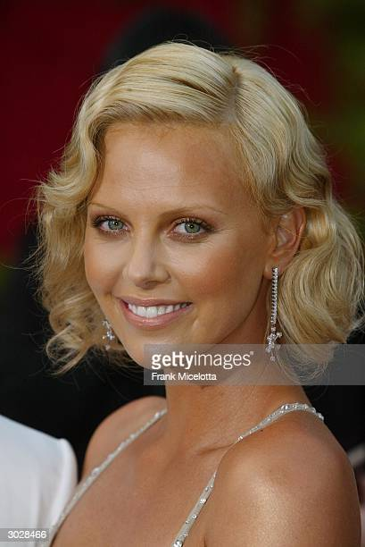 Actress Charlize Theron attends the 76th Annual Academy Awards at the Kodak Theater on February 29 2004 in Hollywood California