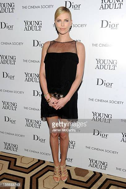 Actress Charlize Theron attends the Cinema Society Dior Beauty screening of 'Young Adult' at the Tribeca Grand Screening Room on November 18 2011 in...