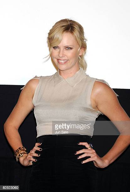 Actress Charlize Theron attends the 'Hancock' Stage Greeting at Shinjuku Piccadilly on August 23 2008 in Tokyo Japan The film will open on August 30...