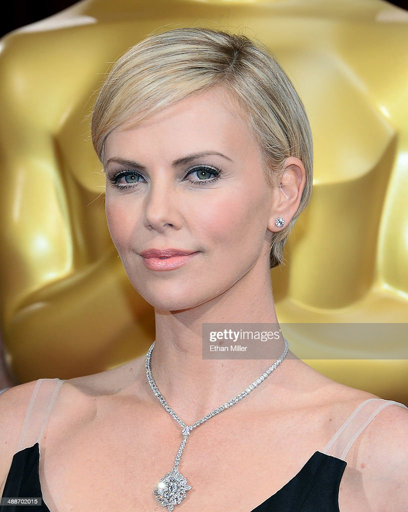 Actress <a gi-track='captionPersonalityLinkClicked' href=/galleries/search?phrase=Charlize+Theron&family=editorial&specificpeople=171250 ng-click='$event.stopPropagation()'>Charlize Theron</a> attends the Oscars held at Hollywood & Highland Center on March 2, 2014 in Hollywood, California.